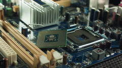 The CPU lies on the motherboard next to the slot chipset Stock Footage