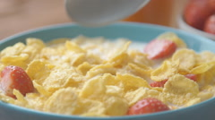 Woman eating breakfast cereals in the morning Stock Footage