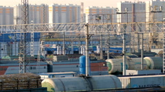 Railway station with freight trains in the background high-rise buildings. Saint Stock Footage