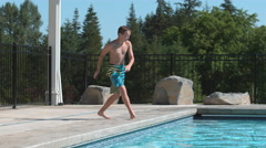 Jumping into pool in super slow motion Stock Footage