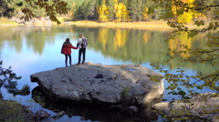 Young Tourists Couple of Lovers on Forest Lake. Autumn Leaf Fall Sunny Day. Stock Footage