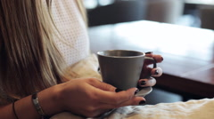 Female hands hold cup of coffee Stock Footage