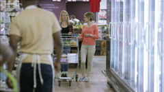 4K Mature lady & adult daughter shopping together in grocery store Stock Footage