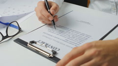 Man completes and signs a contract Stock Footage