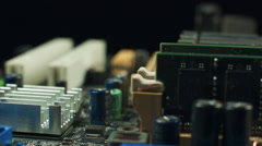 Computer components motherboard are spinning on a black background Stock Footage