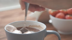 Ceramic cup of hot brown cacao stands on wooden table Stock Footage