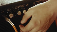 Professional Guitarist Adjusting Guitar Amp At Home Studio. Close Up Stock Footage
