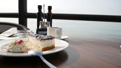 Breakfast with cake in a cafe on the beach. Stock Footage