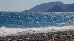 Background of waves of the sea on the beautiful pebble beach Stock Footage