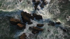 Overhead view of waves crashing on rocks, Lincoln City, Oregon Stock Footage