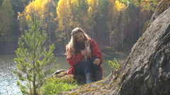 Asian Girl With a Dog on the Bank of the Lake. Autumn. Stock Footage