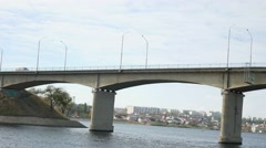 Ship bridge sails under the bridge on the bridge going car traffic sea Stock Footage