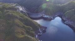 Sideways flight panning along Gordon Dam and Lake, Tasmania, Australia Stock Footage