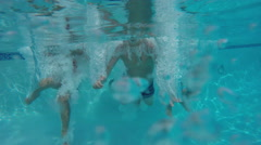 Kids jump into pool and go underwater Stock Footage