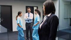 Portrait of female doctor standing with arms crossed in hospital Stock Footage