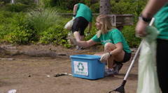 Group of volunteers cleaning up park Stock Footage