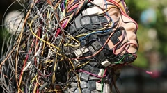 Woman face of sculpture, made of electric wires and electronic devices Stock Footage
