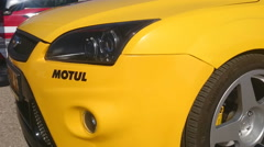 Yellow sport car side view Stock Footage