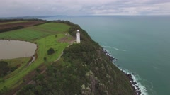 Beautiful cinematic flight around Table Cape Lighthouse revealing cliffs Stock Footage