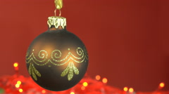 Xmas bauble looping on red background Stock Footage