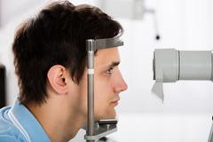 Close-up Of A Young Man Checking Eyesight In Clinic Stock Photos