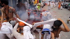 Firecrackers explode over devotees of Chinese Jui Tui shrine Stock Footage