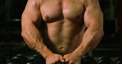 Muscular man lifting kettle bell Stock Footage