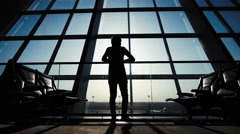 Silhouette of a man traveler with backpack. business and travel Stock Footage
