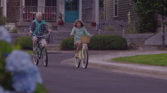 Senior couple riding bicycles together Stock Footage