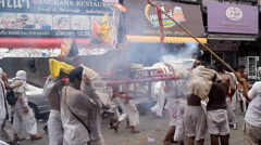 Firecrackers explode over devotees of Chinese Jui Tui Stock Footage