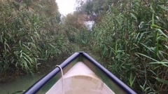 With boat through a small river at the Danube Delta Stock Footage