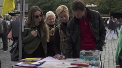Passers by signing a pro-Ukrainian petition at the Prague Stock Footage