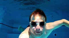 Man Swimming Underwater On Sunny Swimming Pool Stock Footage