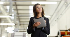 4k, Attractive businesswoman standing inside a printing and packaging plant Stock Footage