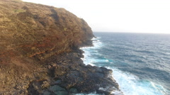 Rugged Hawaii Coastline and Waves With Hikers And Lighthouse Stock Footage