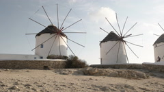 Panning shot of the historic windmills on mykonos, greece Stock Footage