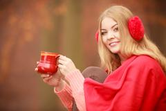 Girl with cup in park. Stock Photos