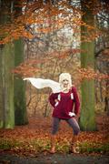 Fashion girl in autumnal park, outdoor Stock Photos