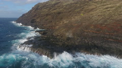 View Rugged Hawaii Coastline With Swimmers and Big Waves Stock Footage