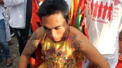 Devotees of a Chinese Jui Tui Shrine go into a trance Stock Footage