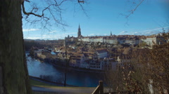 Beautiful European city on river bank, cozy houses and churches on winter day Stock Footage