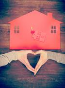 Heart and house symbol Stock Photos
