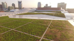 Low Over Massive Green Roof Downtown Nashville Skyline Stock Footage