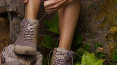 Couple hiking, closeup of tying shoes Stock Footage