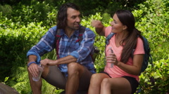 Couple taking break from hike to have water Stock Footage