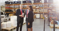 4k, Three warehouse workers discussing logistics of their business in warehouse Stock Footage