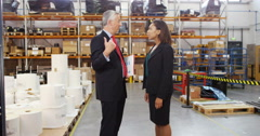 4k, Shot of a man and woman inspecting inventory in a large distribution warehou Stock Footage