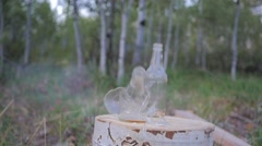 Glass bottle used for firearm target practice. Stock Footage