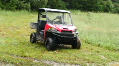 Driving 4 wheeler / gator type vehicle through grass Stock Footage