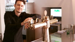 Bar tender standing at bar counter Stock Footage